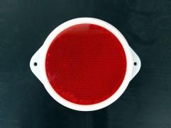 Odrazka červená kruhová s ušami fí 80mm (priemer reflexnej plochy)